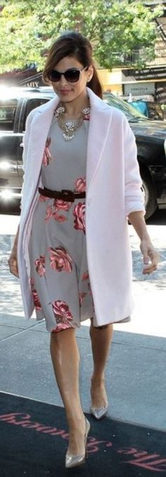 Who made  Eva Mendes' pink coat, brown pumps, and rose print dress that she wore in New York?