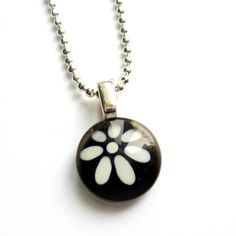 Black and white flower pendant  hand painted glass  by azurine, $20.00