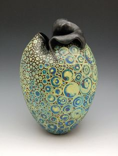 Melanie Ferguson, inlaid underglaze, wonder what it would look like to make some canes using colored clays, and use the slices to decorate the outside of a pot. #decorative technique #inspiration