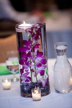DIY Submerged Orchid Centerpiece with floating candle. : wedding green purple silver flowers diy reception Thurston HarshmanWedding323PROOFS #xmas_present #Black_Friday #Cyber_Monday