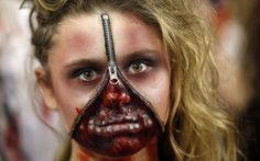 A member of the Dallas Cowboys' cheerleading troupe dressed in a zombie costume performs at halftime during the game against the Washington Redskins in Arlington, Texas