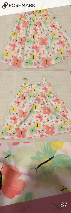 Beautiful butterfly print dress White with butterfly print. And yellow bow. One missing button and spot as in picture. Size 5 Dresses