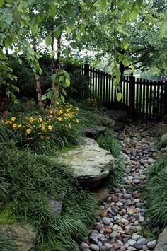 I like the idea of a creek bed without the   creek, just the illusion of water.