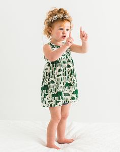 Adorable redhead baby girl in green and white dress perfect for summer. Easy outfit and so cute campground illustration printed on organic cotton. Made in the USA for Noble Carriage by Winter Water Factory. Complete with flower crown, boho babe hipster style.  PHOTOGRAPHY BY: http://studiocastillero.com/