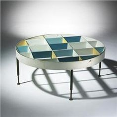 Gio Ponti's coffee table that he designed for the Villa Arreaza, Caracas, Venezuela.  Love the use of different colors on the vertical planes.