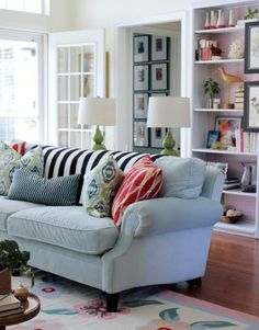 love the colors + patterns of this livingroom