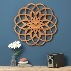 Laser cut clock by Owl & Otter http://www.notonthehighstreet.com/owlandotter/product/large-modern-geometric-clock