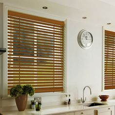 A traditional dark Rose Brown coloured wood blind, available in a 35m and 50mm slat width.
