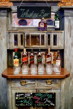 Whiskey bar set up on an antique hutch | Photo by WhiteSmoke Studio via  http://junebugweddings.com/wedding-blog/sweet-wedding-warsaw/