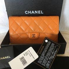 5f87e92ef584e9 Authentic Chanel Full size wallet Authentic Chanel puch hole wallet in  orange. This wallet comes