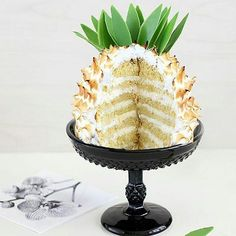 Pineapple anyone? Regran from @the_cookie_fairy - Pineapple shaped cake, with coconut-pineapple filling is yummmmmm! .