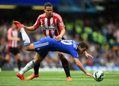 Eden Hazard Photos - Eden Hazard of Chelsea is brought down by Jack Rodwell of Sunderland during the Barclays Premier League match between Chelsea and Sunderland at Stamford Bridge on May 24, 2015 in London, England. - Chelsea v Sunderland - Premier League