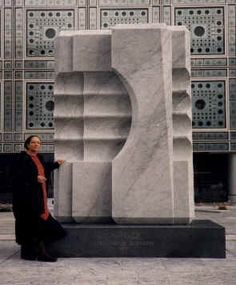 The Jordanian sculpturist, Mona Saudi with her sculpture in front of Arab Institute, Paris