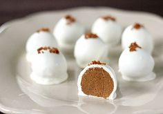 These totally look yummy  Pumpkin Cream Cheese Truffles!