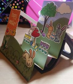 Card by Claire Morrison: Lawn Fawn Happy Easter side view. I also used a few stamps and dies from Gleeful Gardens, Critters on the Farm (small chicken and small egg), and the tree is from Let's Play. Oh, and the the two bunnies on the back tier are from Snow Day. #LawnFawn