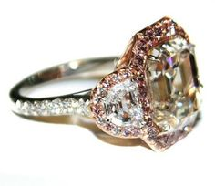 I've long thought about adding a rose-gold and pink diamonds element to my ring...this one is gorgeous!!!