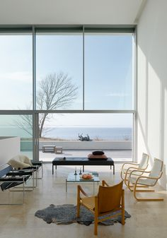 Concrete Beauty: Situated on the west coast of the Baltic island of Öland, Villa Widlund stands out as a solid white, geometric, concrete landmark in perfect contrast with a backdrop of picturesque ocean views and serene beach landscapes. Construction and furnishings are minimal so that each room highlights the windows and spectacular outdoor views. Everything about this modern beach villa is dreamy – I'd have trouble deciding to be in or out!    Designer: Claesson Koivisto Rune Architects