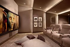 The cosy, luxurious cinema room features the best audio-visual systems