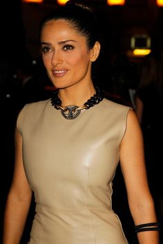 Salma Hayek Pinault in beige leather dress....also love the accessories..