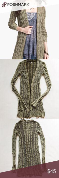 """Free People Rip Tide Cable Cardigan Free People Rip Tide Cable Cardigan in sage green featuring hidden front snap.  Open knit, oversized fit.  Pre-loved but in excellent condition.  No holes, stains or tears.  Slightly stretched at neckline from hanging.  Measurements laying flat: Armpit to armpit: 14"""" Waist (across): 12.5"""" Total length: 35""""  Sleeve length: 31"""" Free People Sweaters"""