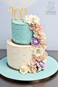 "Vintage style cake celebrating a 100th birthday with color and sugar flowers. Custom fondant cake worthy of a centennial - this is ""AHMazing!""!"