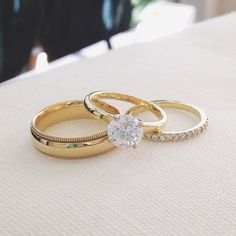 Beautiful matching yellow gold engagement and wedding rings.
