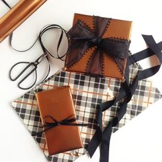 Learn wrapping tips and tricks for wrapping with metallic paper. Perfect for Fall and holiday celebrations!