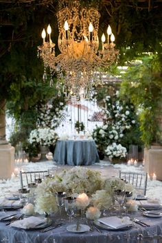 chandelier at outdoor reception, wedding tablescapes.