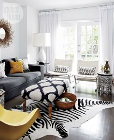 Living room in stylish black, white, yellow