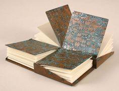 Jim Norton, Athens, GA, USA. Pinwheel Book. Etched Copper with Patina. 18.5 x 18.5 x 1.5 cm. MFA University of Georgia in Jewlery & Metals 2007.