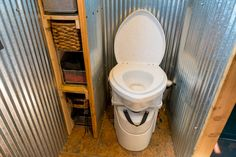 What is a tiny house composting toilet? How does it work? Where do you dump it? What are the advantages? This article answers these questions, with photos!