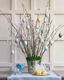Easter egg tree-  Fill an ice bucket with floral foam, then insert grass and pussy willow branches. Or place pebbles and water into a vase, and make an arrangement using any type of fresh-cut branches, such as flowering quince, magnolia, forsythia or cherry blossom.