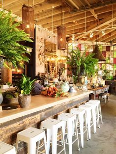 Modern rustic design at the Rolling Greens home & flower shop. Rustic Coffee Shop, Coffee Shop Bar, Coffee Shop Design, Rustic Cafe, Coffee Coffee, Modern Rustic, Shop Interior Design, Cafe Design, Rustic Design