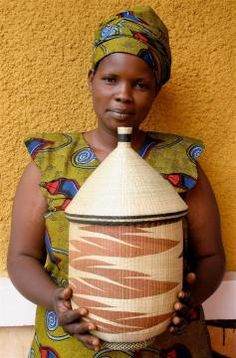 Gahaya Links member Christine Uwera with one of her peace baskets. Photograph courtesy of Willa Shalit, Fair Winds Trading. On view August 2012 to May 2013 at Carnegie Museum of Natural History. Burke Museum, Clyfford Still, Barnes Foundation, Carnegie Museum, Harvard Art Museum, Corning Museum Of Glass, Jewish Museum, Van Gogh Museum, Royal Academy Of Arts