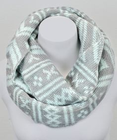 Layering up never looked so chic. With a classic Fair Isle knit pattern, this infinity scarf adds a cozy, stylish bit of warmth to a cool-weather ensemble. 11'' W x 27'' circumference100% acrylicHand washImported