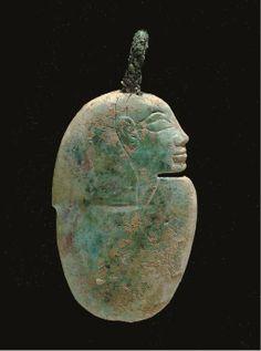 AN EGYPTIAN GLASS HEART AMULET -  NEW KINGDOM, DYNASTY XIX, 1307-1196 B.C.