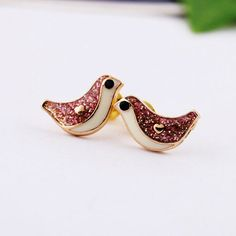 "Size:+Height:+0.8CM(0.31""+)++Width:+1.3CM(0.51""+)+  Style:+Lovely  Color:+As+Picture  Material:+Alloy+  Fashion+element:+Bird+Shape  The+bird+is+a+lovely+angel+in+the+nature.+when+you+wear+this+earring.+You+are+angel!Features+the+rhinestone+bird+shape.+It+looks+bling+and+cute.+In+it,+yo..."