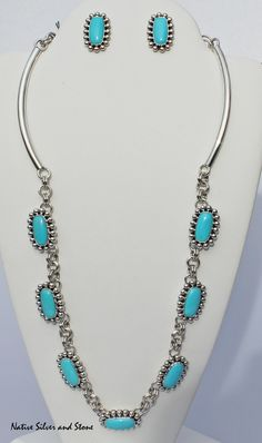 Spectacular handmade set from famed Navajo jewelry designer, Artie Yellowhorse.  Natural turquoise from the legendary Sleeping Beauty mine (closed in 2011). The squared ovals are set in Artie's signature sterling silver beaded perimeters. Matched set of necklace and earrings.  From Native Silver and Stone