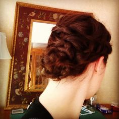 Waterfall braid into a waterfall twist combined into a four strand braid twisted into a bun.....it sounds more complicated than it is!