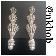 Rhinestone and Pearl Fan Earrings Silver rhinestone and Pearl accent fan earrings in graduated sizes. 3.25 inches long never worn comes in a velvet pouch (CBJ) Boutique Jewelry Earrings