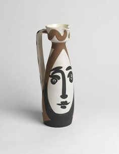 """PABLO PICASSO  Face.    Partially glazed terre de faïence turned pitcher painted in black, white and brownish red, 1955. 300 mm; 11 7/8 inches (height). Edition of 500. Inscribed """"Edition Picasso Madoura"""" in black and with the Madoura and Edition Picasso stamps on the base. Ramié 288.  Estimate 5,000-8,000 dollars"""