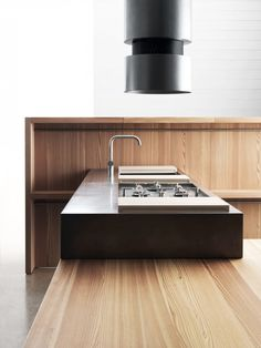 The second version of the Convivio, called Forgia, has a hand-brushed and hand-forged stainless steel countertop and hood. The wood shown here is larch in an oiled finish. Lando Convivio Kitchen | Remodelista