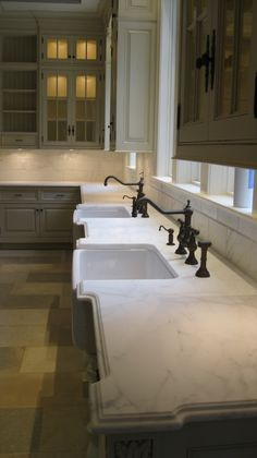 Love the painted cabinets with the marble countertops! I would live this for my future home...