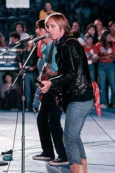 'm nearly positive this is Tom with Jackson Brown at The No Nukes concert, Sept. 23, 1979. I was there. :-P