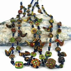 Fine collection of ancient glass & mosaic beads including many Roman pieces. Excellent examples of miniature ancient world glass bead-art. Turquoise Beads, Gold Beads, Gemstone Jewelry, Beaded Jewelry, Jewelry Crafts, Jewelry Art, Antique Jewelry, Jewellery, Baubles And Beads