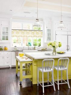 Love the khaki countertops with white cabinets (and white fronted appliances!!), farm house sink with huge windows and bright island with carerra marble top!