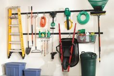 Easy to do garage organization...looping the extension cords on hooks makes so much sense.