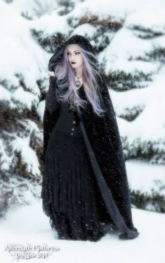 Female fantasy characters. Witch with violet hair. Black cloak