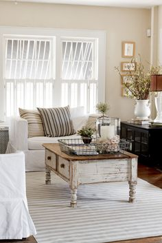 vintage chic living room....beautiful in theory. White just won't do with a little boy around.