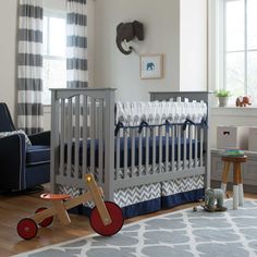 Navy and Gray Elephants Crib Bedding | Carousel Designs. Marching their way into your nursery and right into your heart, these precious elephants are sure to light up the room. Complete with polka dots and zig zags in incredible shades of navy and gray this adorable crib bedding collection will no doubt become an instant success in your nursery.